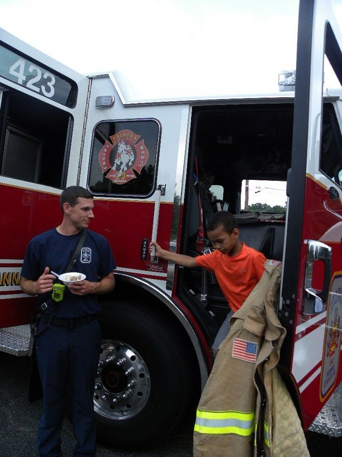 Paul Serzan, of Fire Station 423, shows the truck's controls at the Rutherford Night Out ...