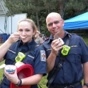 Firefighters Dawn Blair-Jimenez and Barry Rathbone, of Fairview Station 432, take an ice cream break at the Middleridge Night Out on Tuesday, Aug. 5.