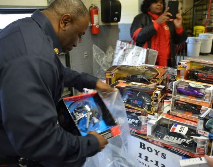 Firefighters Distribute Toys and Coats to Local Children